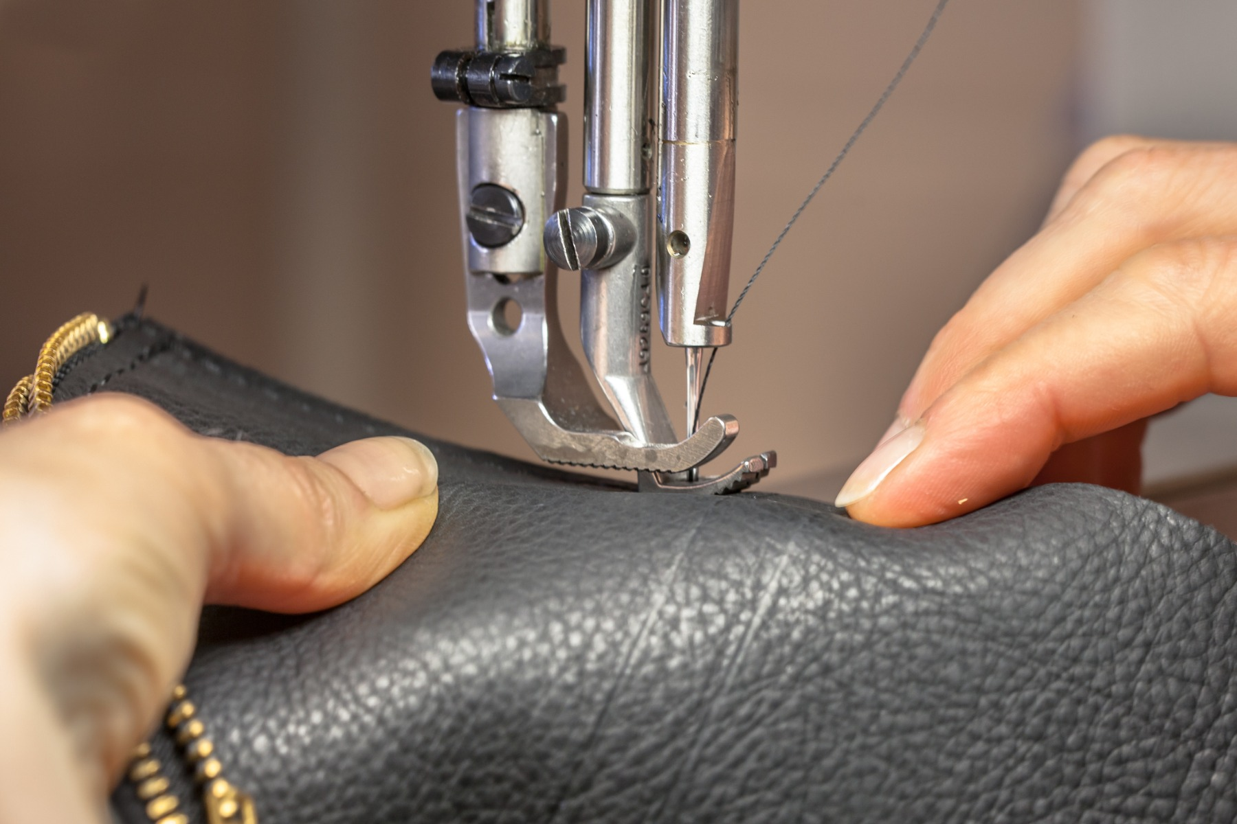an example of the care needed to sew leather together